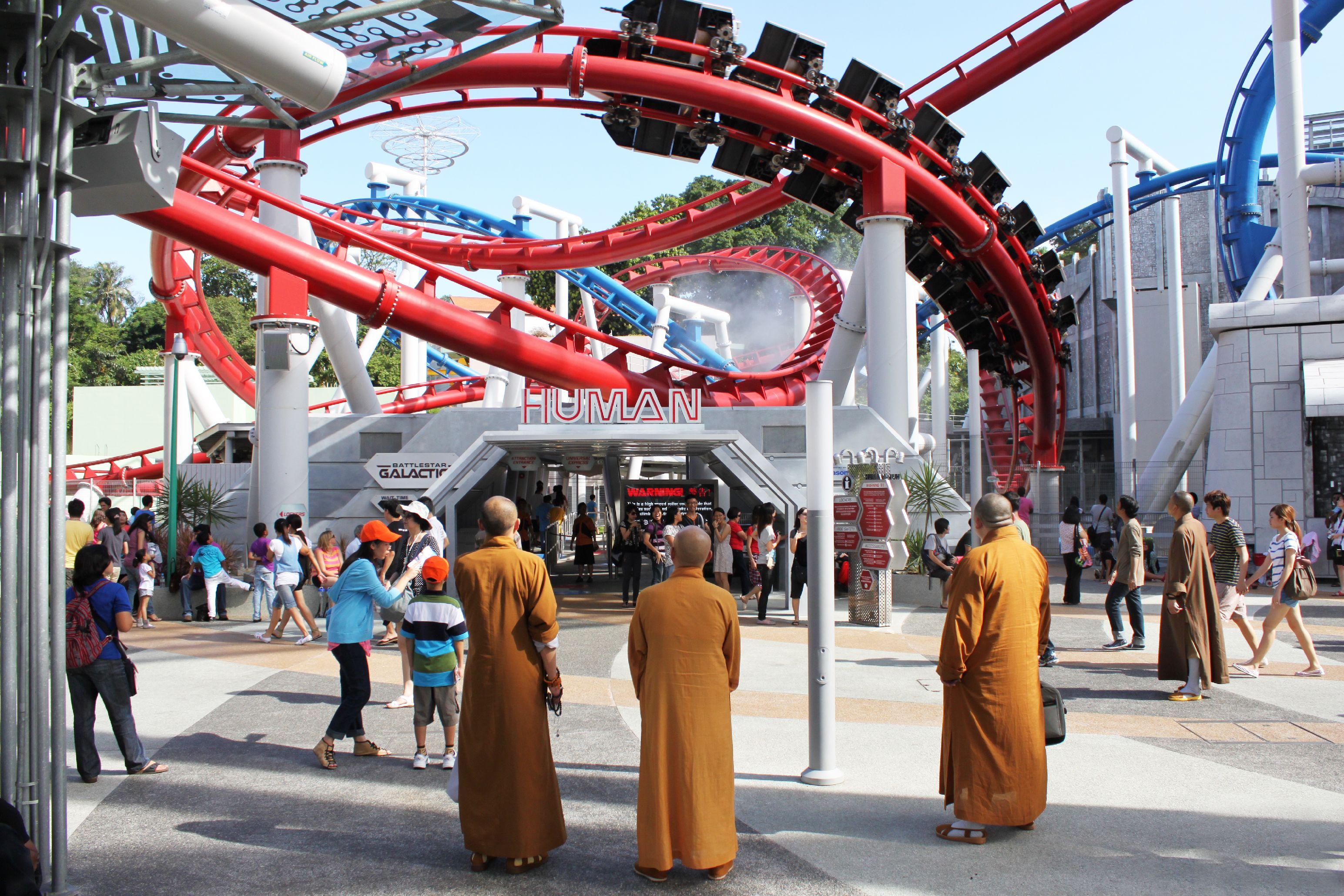monks in front of roller coaster ashton morris